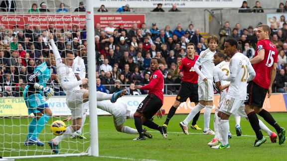 Patrice Evra heads home to give Manchester United the lead at Swansea