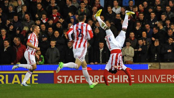 Kenwyne Jones celebrates acrobatically after putting Stoke into the lead against Liverpool