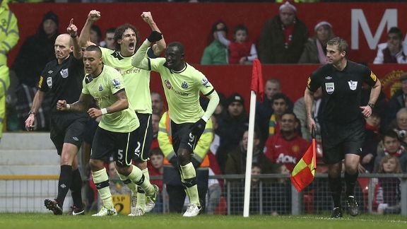 Papiss Cisse and his Newcastle team-mates celebrate a goal against Manchester United at Old Trafford