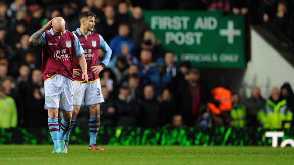 Stephen Ireland and Chris Herd show their frustration as Aston Villa go 3-0 down against Wigan