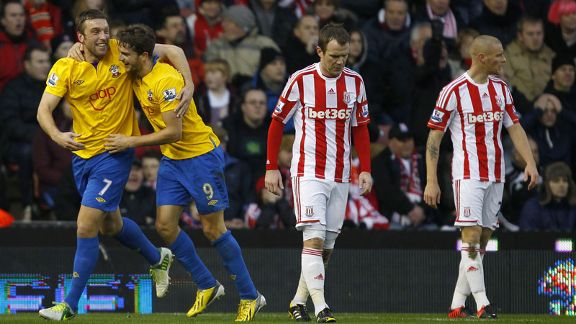 Southampton's Rickie Lambert and Jay Rodriguez celebrate taking a 3-1 lead at Stoke through Andy Wilkinson's own goal