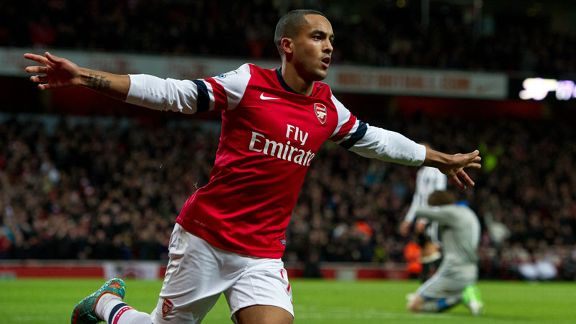 Theo Walcott celebrates putting Arsenal into the lead against Newcastle