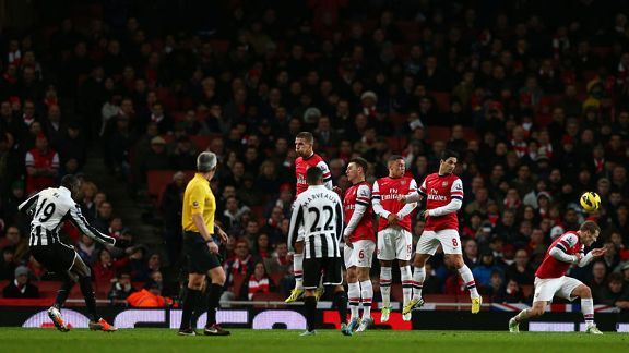 Demba Ba's free-kick takes a deflection from Jack Wilshere to level the scores at 1-1