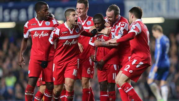 QPR players celebrate after taking the lead against Chelsea