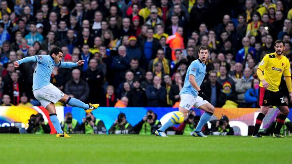 Carlos Tevez fires Manchester City into an early lead against Watford