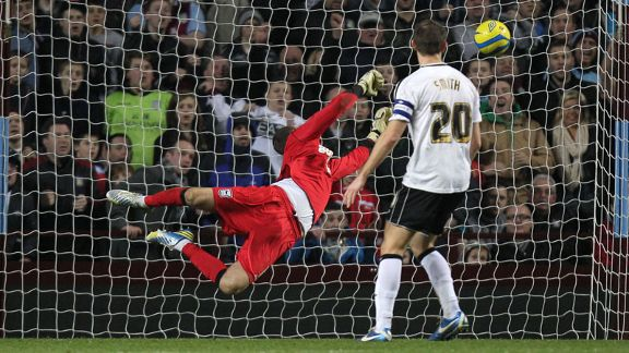 Ipswich goalkeeper Scott Loach fails to keep out Andreas Weimann's effort as Aston Villa win 2-1