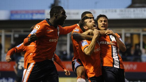 Luton celebrate after taking the lead against Wolves through Alex Lawless