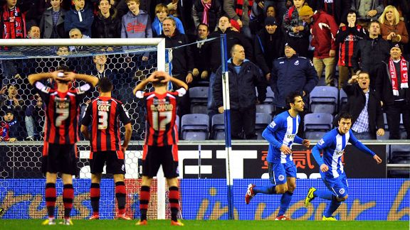 Wigan celebrate after drawing level through Jordi Gomez