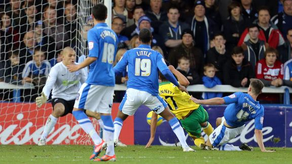 Elliott Bennett nets the opener for Norwich against Peterborough