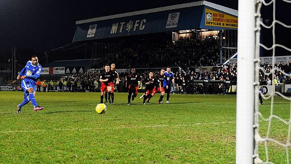 Matthew Barnes-Homer fires Macclesfield into the fourth round from the spot