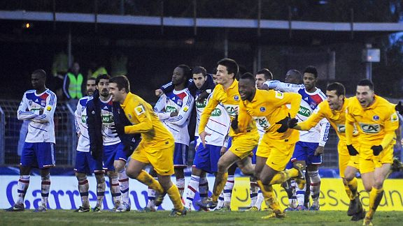 The celebrations begin for Epinal as Lyon's players can only look on in horror