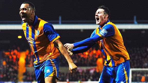 Lee Beevers celebrates with goalscorer Matthew Green after Mansfield grabbed their consolation against Liverpool