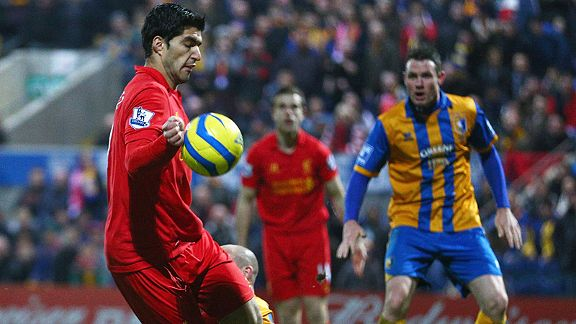 Luis Suarez controls the ball with his hand before scoring what proved to be Liverpool's winner at Mansfield