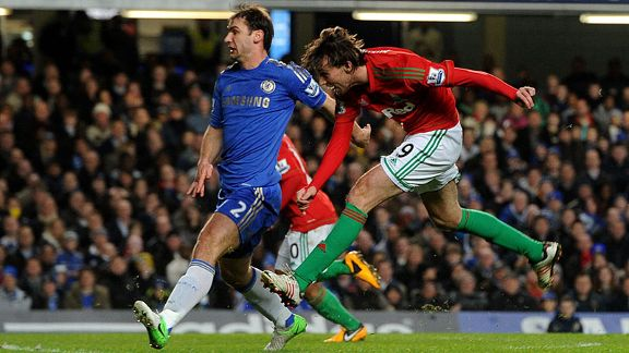 Michu fires Swansea into the lead at Chelsea