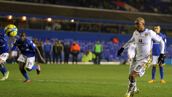 El-Hadji Diouf scored for Leeds as they earned an FA Cup fourth round tie with Spurs