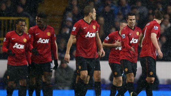 Manchester United celebrate taking the lead at Tottenham through Robin van Persie