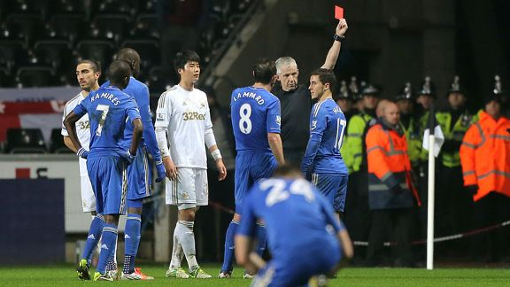Chelsea's Eden Hazard receives a red card from referee Chris Foy for violent conduct