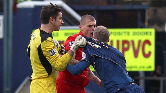 Tempers flare as Liverpool's Martin Skrtel confronts Oldham's Robbie Simpson after a late challenge on Brad Jones