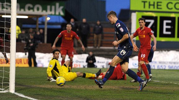 Matt Smith scores Oldham's second goal to restore their lead