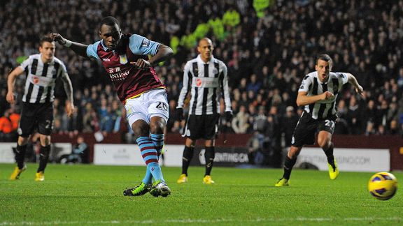 Christian Benteke slots home a penalty for Aston Villa to reduce the arrears