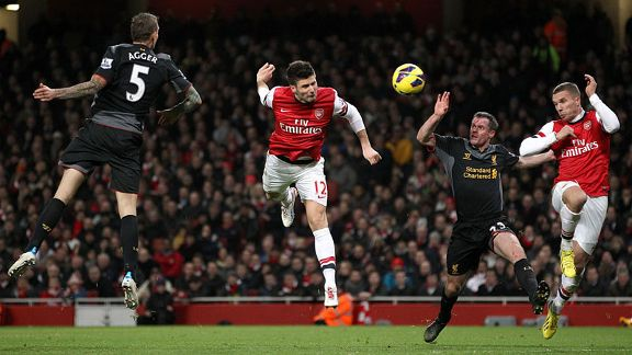 Olivier Giroud heads home to put Arsenal back into the game