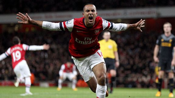 Theo Walcott celebrates netting the equaliser against Liverpool
