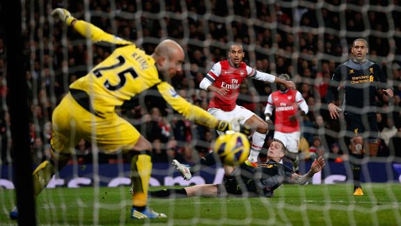 Theo Walcott fires home the equaliser for Arsenal