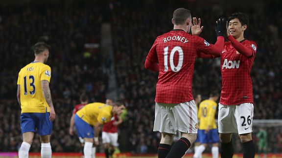 Wayne Rooney celebrates with Shinji Kagawa after netting the equaliser against Southampton