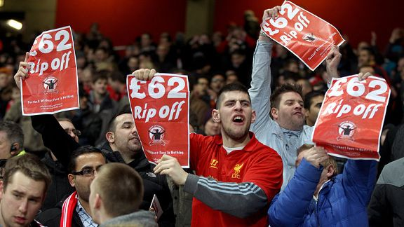Liverpool fans protest the price of tickets at Arsenal before kick-off at the Emirates