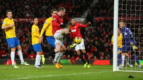Wayne Rooney turns home his second goal of the night to put Manchester United 2-1 up