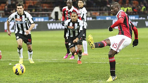 Mario Balotelli scores from the spot in the 94th minute to earn a 2-1 win for Milan against Udinese