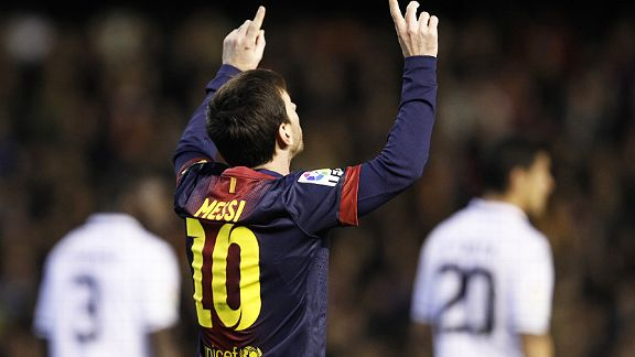 Lionel Messi celebrate after putting Barcelona back on level terms at Valencia from the penalty spot