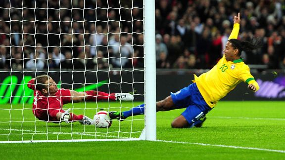 Ronaldinho tries in vain to score the rebound after Joe Hart saved his penalty