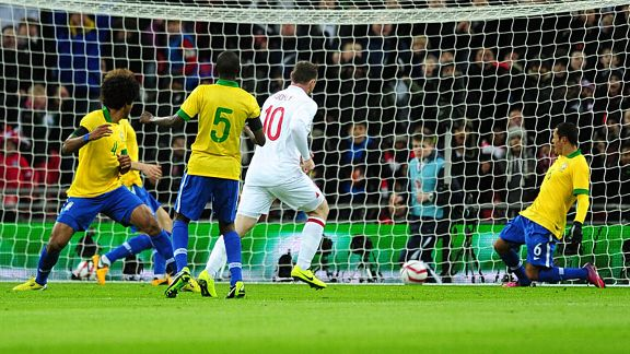 Wayne Rooney passes the ball into an unguarded net to give England the lead