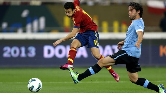 Spain forward Pedro fires the first of his two goals in the 3-1 victory over Uruguay