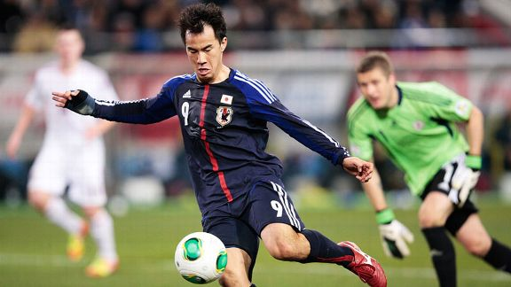 Shinji Okazaki scores his second goal for Japan in the 3-0 defeat of Latvia