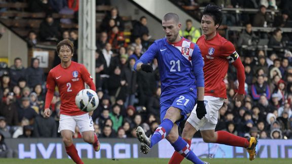 Fulham's Mladen Petric fires home the final goal of Croatia's 4-0 victory over South Korea at Craven Cottage