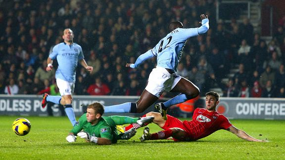 Manchester City goalkeeper Joe Hart makes a save but Jason Puncheon was on hand to score the rebound