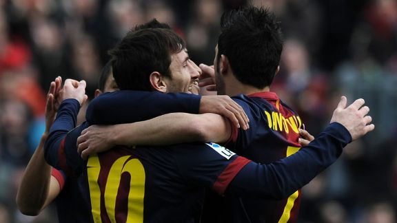 Lionel Messi celebrates with his team-mates after putting Barca 2-0 up