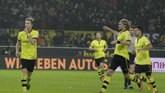Marco Reus scored a hat-trick for Dortmund as they beat Frankfurt in the Bundesliga