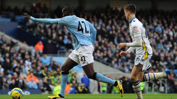 Yaya Toure scores Man City's opening goal in their FA Cup fifth round tie against Leeds