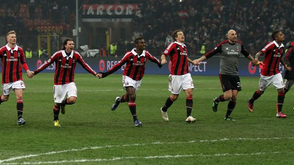 AC Milan players celebrate as a team following their 2-0 victory against Barcelona in the Champions League