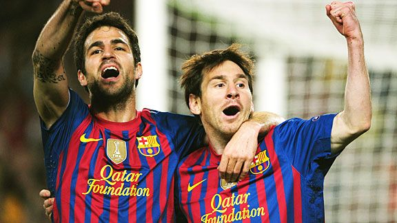 Cesc Fabregas and Lionel Messi celebrate