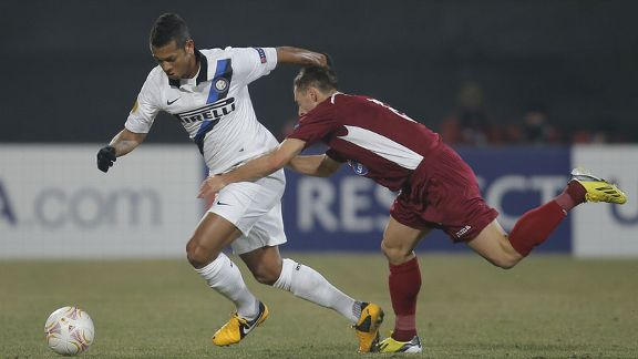 Fredy Guarin scored twice for Inter as they navigated their way into the Europa League quarter-finals