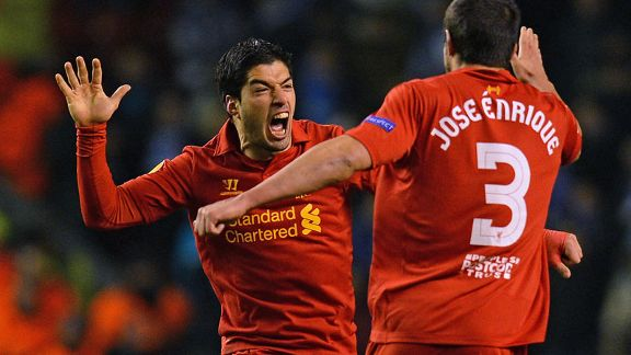 Luis Suarez is congratulated after scoring his second goal of the night for Liverpool against Zenit