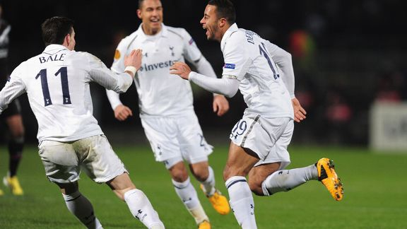 Mousa Dembele celebrates his super strike against Lyon in the Europa League