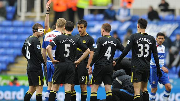 Reading striker Pavel Pogrebnyak is shown a red card against Wigan.