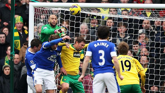 Tim Howard punches clear from Grant Holt - but the Norwich striker had the last laugh with an injury-time winner at Carrow Road.