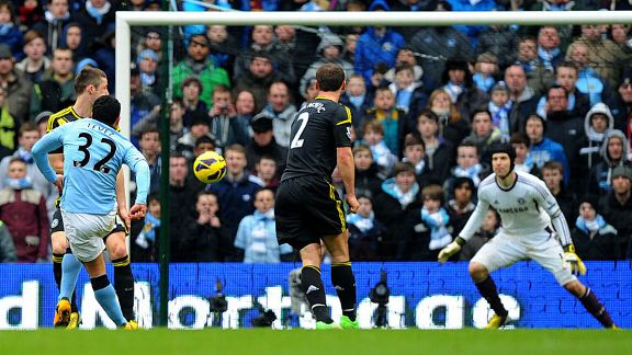 Carlos Tevez scores