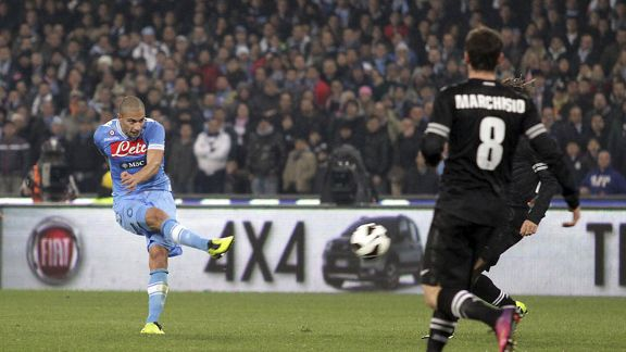Gokhan Inler scores for Napoli in their 1-1 draw with Juventus